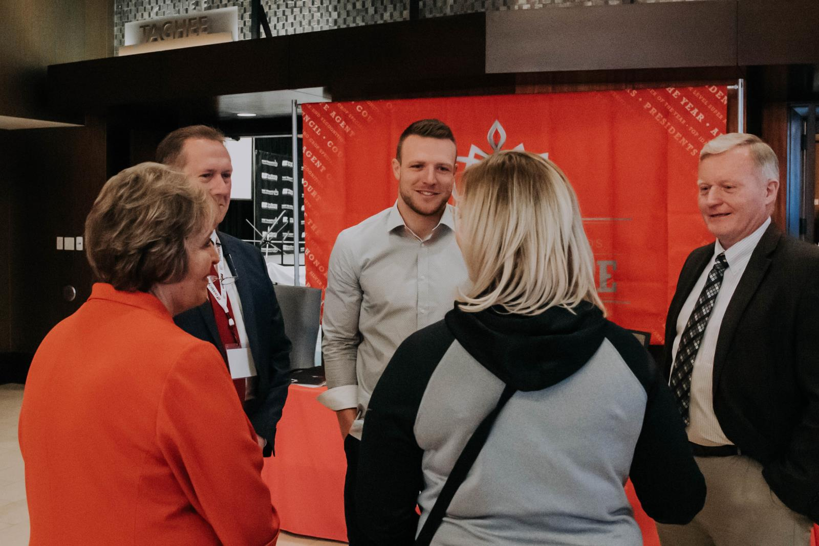 Pocatello native and NFL player Taysom Hill, center, speaks to Farm Bureau Mutual Insurance Co. of Idaho insurance agents in February. Hill is teaming up with the Idaho Potato Commission to help promote the state's most famous commodity.