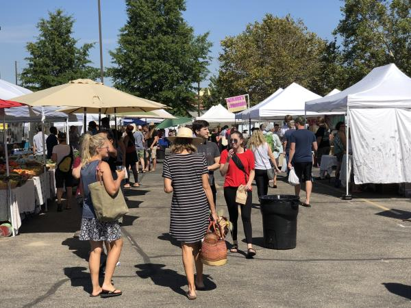 People shop at the Boise Farmers Market during a Saturday in August. Vendors say the market's move to a new location this year has worked out better than they could imagine.