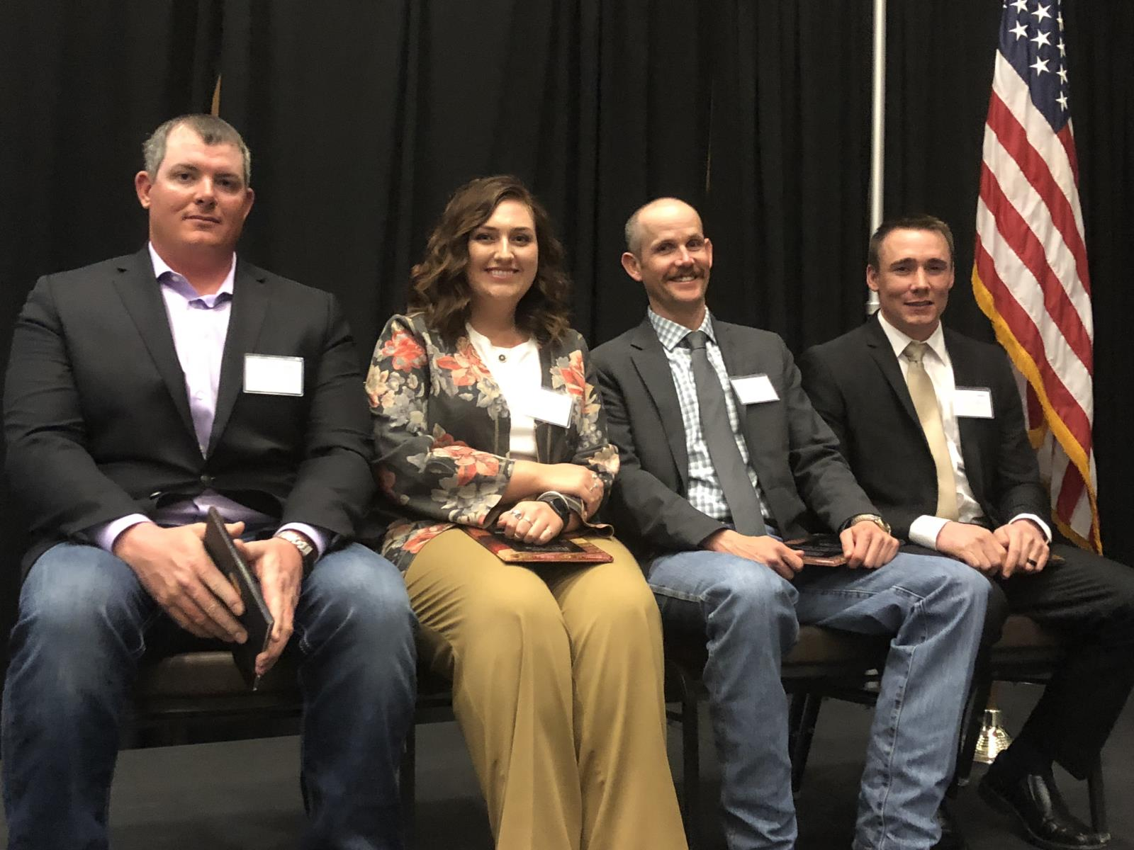From left, Sedar Beckman, Saydee Longhurst, Rob Cope and Kenny Dalling receive young producer awards March 13 during the Eastern Idaho Agriculture Hall of Fame's annual induction ceremony.