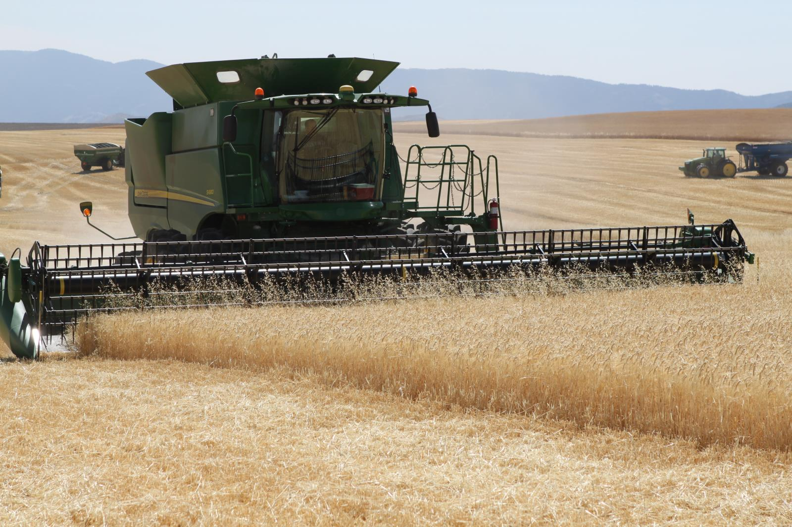 A barley field near Soda Springs is harvested in September. A recent Gallup poll showed that Americans feel more positive about farming and agriculture than any other industry.